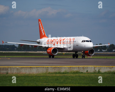 G-EZTX easyJet Airbus A320-214 taxiing at Schiphol (AMS - EHAM), The Netherlands, 18may2014, pic-2 - Stock Photo