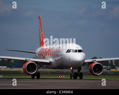 G-EZTX easyJet Airbus A320-214 taxiing at Schiphol (AMS - EHAM), The Netherlands, 18may2014, pic-3 - Stock Photo