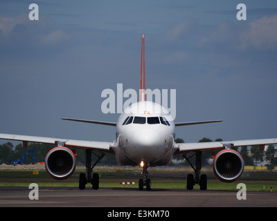 G-EZTX easyJet Airbus A320-214 taxiing at Schiphol (AMS - EHAM), The Netherlands, 18may2014, pic-4 - Stock Photo