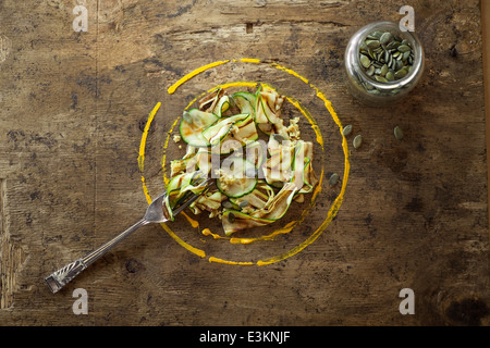 Courgette Ribbon Salad With Pumpkin Seeds. - Stock Photo