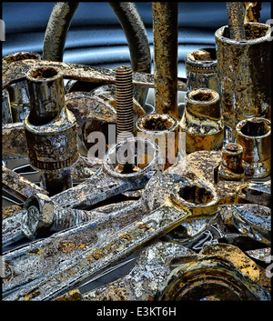 This is a still life image of some old rusty bolts,sockets and spanners - Stock Photo