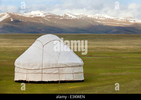 View of national asian yurt in mountains - Stock Photo