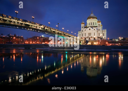 Winter view of orthodox church of Christ the Savior and Patriarchal Bridge at night in central Moscow, Russia - Stock Photo