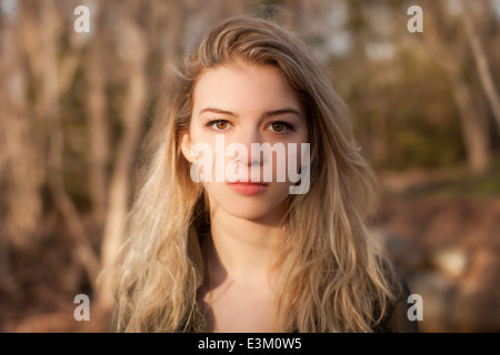 Portrait of young adult woman (18-19) looking at camera - Stock Photo
