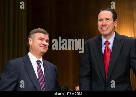 Washington DC, USA. 24th June, 2014. Michael White, chairman and CEO of DIRECTV, left, and Randall Stephenson, president - Stock Photo