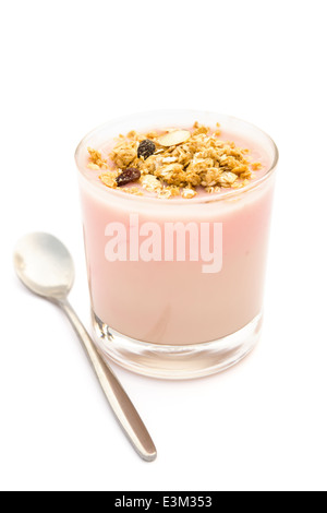 wholegrain muesli on top of strawberry flavor yogurt with clipping path, vertical - Stock Photo