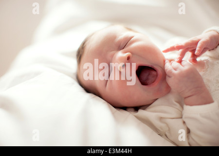 Yawning baby girl (0-1 month) - Stock Photo