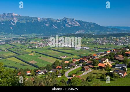 View from Planken across the Rhine valley to the Alpstein mountain range, Principality of Liechtenstein - Stock Photo