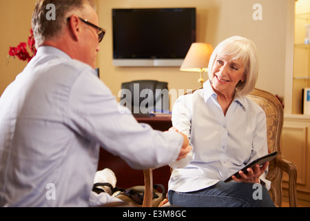 Man Talking To Female Counsellor Using Digital Tablet - Stock Photo