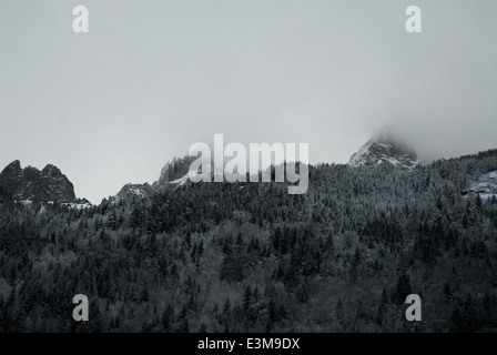 Mountainside in the mist, the French Alps - Stock Photo