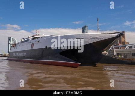 The Isle of Man ferry the Manannan catamaran leaves Liverpool waterfront bound for Douglas in a morning departure. - Stock Photo