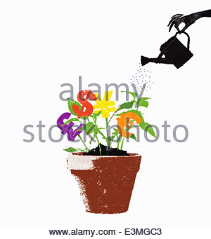 Hand watering international currency symbols growing in plant pot - Stock Photo