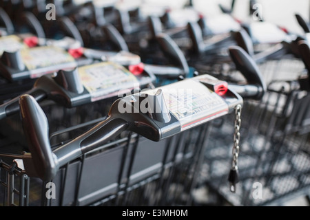 Shopping carts arranged in supermarket - Stock Photo
