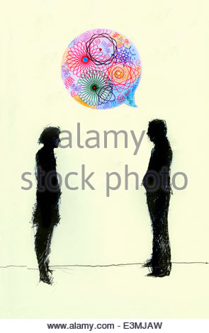 Businessman talking to businesswoman in colorful pattern speech bubble - Stock Photo