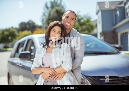 Portrait of smiling couple in driveway - Stock Photo