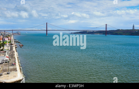 view of waterfront and The 25th of April Bridge from the top of the Monument to the Discoveries, Lisbon, Portugal - Stock Photo