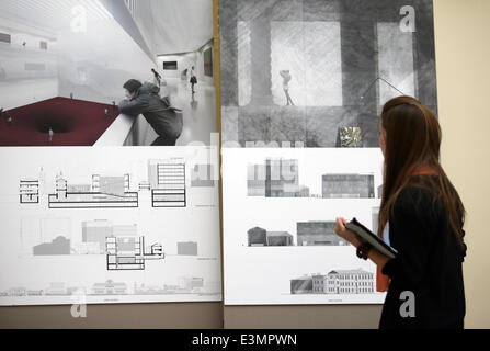 ITAR-TASS: MOSCOW, RUSSIA. JUNE 25, 2014. A woman looks at a project, winner of the close competition for the architectural - Stock Photo