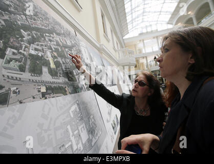 ITAR-TASS: MOSCOW, RUSSIA. JUNE 25, 2014. Women look at a project, winner of the close competition for the architectural - Stock Photo