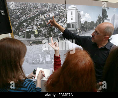 ITAR-TASS: MOSCOW, RUSSIA. JUNE 25, 2014. Architect Yuri Grigoryan (R), head of the 'Project Meganom' architectural - Stock Photo