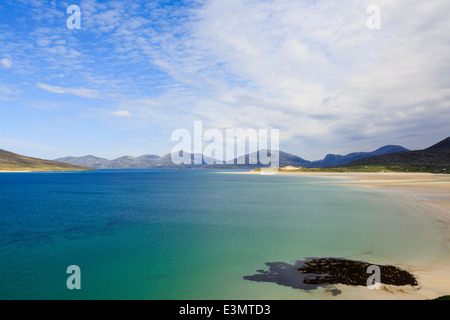 Looking across Sound of Taransay and Traigh Sheileboist beach to mountains of north Harris Outer Hebrides Western - Stock Photo