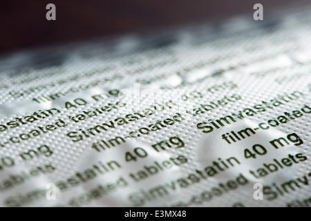 40mg film-coated Simvastatin tablets in foil blister pack - Stock Photo