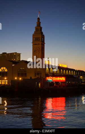 The FERRY BUILDING MARKETPLACE at sunset along THE EMBARCADERO - SAN FRANCISCO, CALIFORNIA - Stock Photo