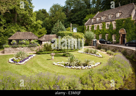 The gardens of the Swan Hotel in the Cotswold village of Bibury, Gloucestershire, UK - Stock Photo