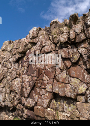Exposed eroded rock wall dyke of igneous Palaeogene basalt intrusion, Rubha an Dunain, Isle of Skye, Scotland, UK - Stock Photo
