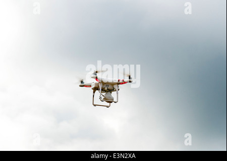 Radio remote controlled camera drone hovering in flight over Lough Foyle, Derry,Londonderry, Northern Ireland - Stock Photo
