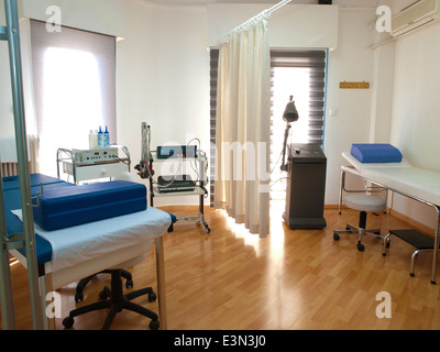 Physical therapy (physiotherapy) room with equipment - Stock Photo