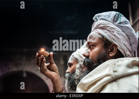 Sadhu inside a temple during the celebrations of Holi, Vrindavan, India - Stock Photo