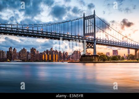 Robert F. Kennedy Bridge (aka Triboro Bridge) at sunset, in Queens, New York - Stock Photo