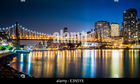Queensboro bridge at dusk viewed from Roosevelt island, New York - Stock Photo
