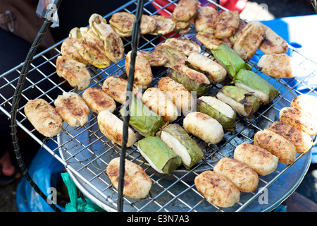 Vietnamese specialty Banana Rice Cake wrapped in leaves grilled - Stock Photo