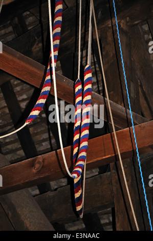 Bell ringing ropes inside St Marys church bell tower, Pembridge, Herefordshire, England, UK, Western Europe. - Stock Photo