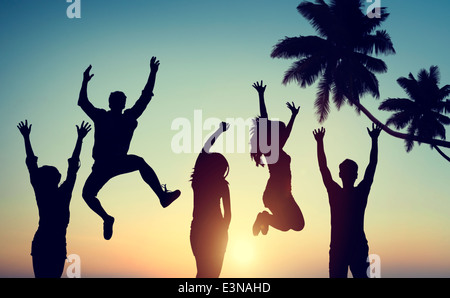 Silhouettes of Young People Jumping with Excitement - Stock Photo