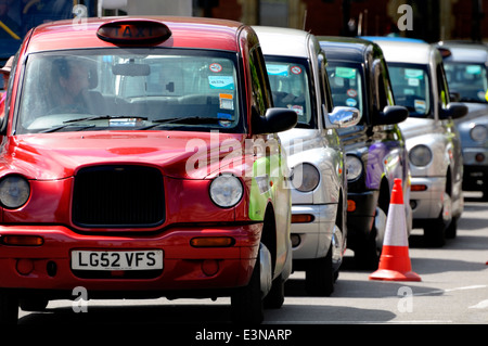 London, England, UK. Line of London taxis, black, white and red - Stock Photo