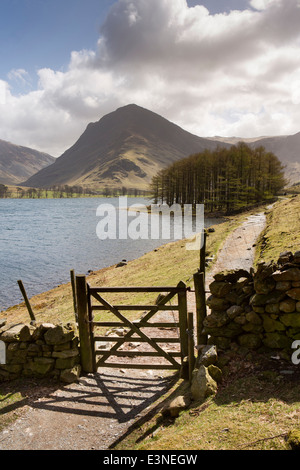 UK, Cumbria, Lake District, Buttermere, gate in path at end of Burtness Wood - Stock Photo