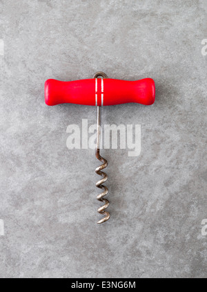 Vintage Corkscrew with Red Wooden Handle - Stock Photo