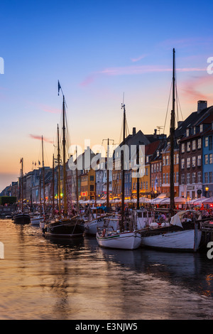 Nyhavn Canal in the evening, Nyhavn, Copenhagen, Denmark - Stock Photo