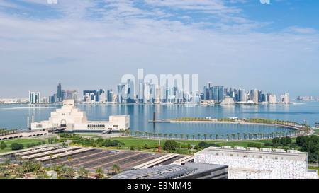 Doha, Qatar, elevated view over Museum of Islamic Art and Dhow harbour to the modern skyscraper skyline - Stock Photo