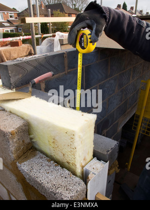Self building house bricklayer laying upper floor for Insulated block construction