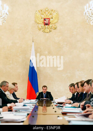 ITAR-TASS: MOSCOW, RUSSIA. JUNE 26, 2014. Russia's prime minister Dmitry Medvedev (C) holds a meeting of the government - Stock Photo
