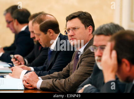 ITAR-TASS: MOSCOW, RUSSIA. JUNE 26, 2014. Russia's energy minister Alexander Novak (C) at a meeting of the government - Stock Photo