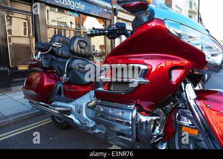 Honda goldwing gold wing motorbike motor cycle motorcycle bike parked red - Stock Photo