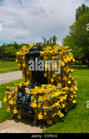 Gas mask sculpture made up of 400 gas masks on May 10 2014, NKD park, central Sofia, Bulgaria, Europe - Stock Photo