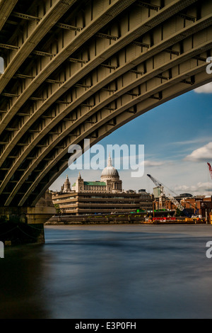 St. Paul's Cathedral from underneath one of the arches of Blackfriars Bridge, London, UK - Stock Photo