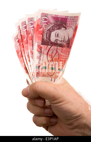 British money, man's hand holding handful of Fifty Pound banknotes - Stock Photo