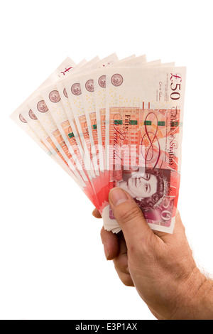 British money, Man's hand holding handful of Fifty Pound banknots - Stock Photo