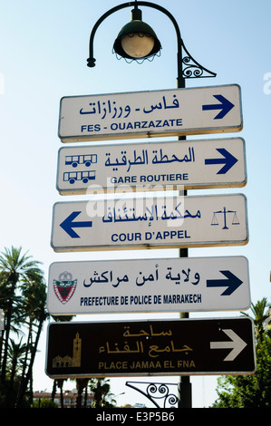 Road signs giving directions to locations in Marrakech, Morocco - Stock Photo